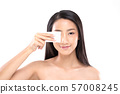 Attractive Charming Asian young woman smile and using tissue with toner for cleaning make up feeling so fresh and clean with healthy skin,isolated on white background,Beauty Cosmetics Concept 57008245