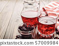 Closeup view at glass of hibiscus ice tea and jug 57009984