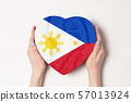 Flag of Philippines on a heart shaped box in a 57013924