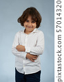 Portrait of smiling kid 57014320