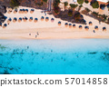 Aerial view of umbrellas, trees on the sandy beach 57014858