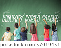 school children drawing happy new year on the 57019451