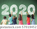 school children drawing 2020 new year on the 57019452