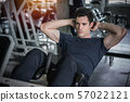 Handsome man exercising doing sit up abdominal 57022121