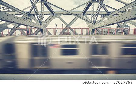 Williamsburg Bridge with subway train in motion,  57027865