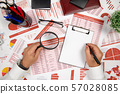 Business reports, blank paper sheet, data tables 57028085