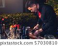 Professional bartender preparing fresh lime 57030810