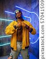 Black rapper in underpass neon light on background 57041509