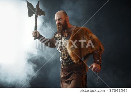 Bearded viking with axe enters the battle 57041545