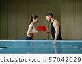 Man and woman on ping pong training indoors 57042029