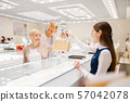 Happy love couple makes purchase in jewellery shop 57042078