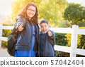 Hispanic Brother and Sister Wearing Backpacks With 57042404