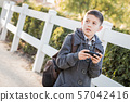 Concerned Young Hispanic Boy Walking With Backpack 57042416
