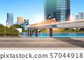 highway road city street with modern skyscrapers train on railway monorail crossing bridge urban 57044918