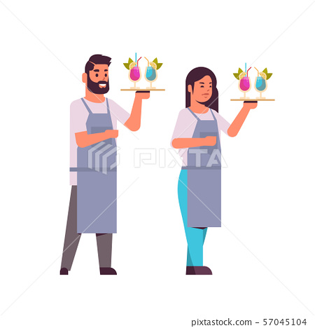 professional waiters couple holding serving trays with cocktails man woman restaurant workers in 57045104
