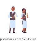 professional waiters couple polishing wine glasses with towel african american man woman restaurant 57045141