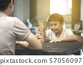 Happy asian family and cute little boy thinking playing a round of wooden block game at home 57056097
