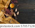autumnal leaves and lit candles 57057128