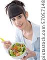 young brunette eats salad 57057148