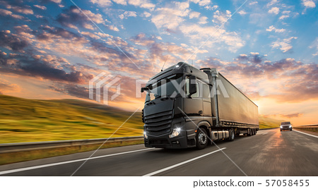 Truck with container on road, cargo transportation concept. 57058455