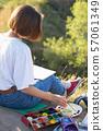 girl painter holds a brush 57061349