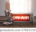 On the air. Old  microphone with vintage signboard 57063130