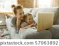 Teacher and little girl, or mom and daughter. Homeschooling concept 57063892