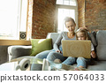 Teacher and little girl, or mom and daughter. Homeschooling concept 57064033