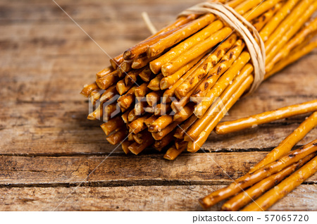Pile of Salty bread sticks on a wooden table 57065720