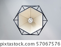 Modern lamp hanging down from ceiling on white 57067576