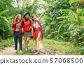 Three asian woman hiking in forest on vacation 57068506