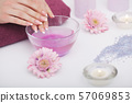 Spa Procedure. Woman In Beauty Salon Holding Fingers In Aroma Bath For Hands. Closeup Of Female 57069853