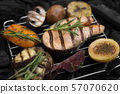 Grilled fish with rosemary and vegetables on grid 57070620