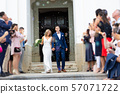 Newlyweds exiting the church after the wedding ceremony, family and friends celebrating their love 57071722