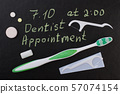 Oral care products on black background. 57074154
