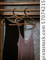 Boho chic open wooden clothing rack 57074215