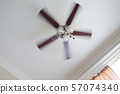Ceiling fan with a ceiling lamp turned on, working 57074340