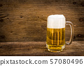 Beer in glass on wood table 57080496