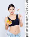 Beautiful portrait young asian woman smiling holding salad vegetable food isolated  57080916