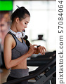 Fitness woman wearing headphone cardio workout at 57084064