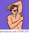 a man shaves his armpit with a razor 57085105