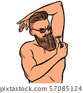 bearded hipster man shaves his armpit with a razor. isolate on white background 57085124