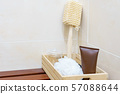 Set of bathroom accessory on wooden basket 57088644