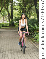 sport woman with bicycle at park 57100567