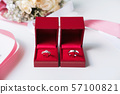 Wedding rings with bouquet of flowers 57100821