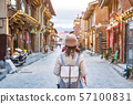 Young woman traveler walking in the old town, 57100831