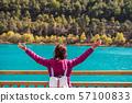 Young woman traveler looking beautiful nature at 57100833