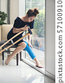 injury woman with leg splint sitting and wooden 57100910