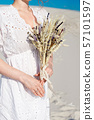 Close-up girl holds in her hands a wedding bouquet with dried flowers. 57101597
