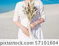 Close-up girl holds in her hands a wedding bouquet with dried flowers. 57101604